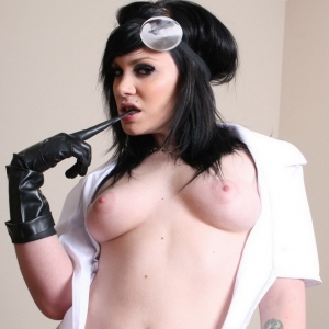 Dexey paige: excited doctor dexey paige shows off her perky breasts as she opens up her uniform.