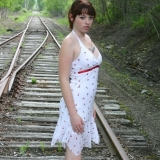 Beautiful babe Barbie teases a lil as she poses on the train tracks in a skimpy sundress
