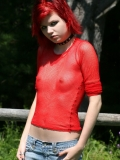 Petite goth teen Luna shows off her perky boobs in a red mesh top outdoors in the sun