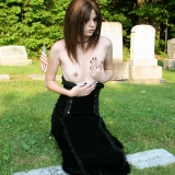 Goth babe Luna shows off her perky tiny boobs in the warm sun at a graveyard