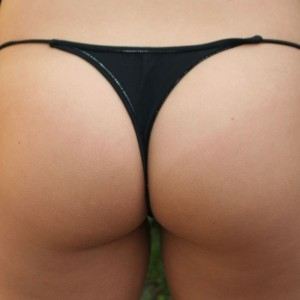 Teen shows off her tight ass in a black thong