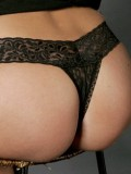 Daisy shows off her round little ass in sexy black lace panties