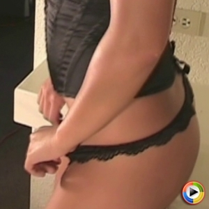 Lili Jensen teases in a very sexy and tight black corset with a matching thong