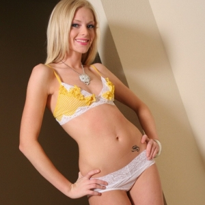 Skye model: graceful teen skye teases in a yellow lace bikini top that she quickly strips out of.